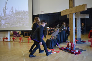Students laying wreaths