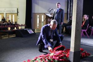 Dr Pawson laying wreath
